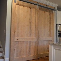 Barn Doors - These two sliding barn doors are absolutely stunning. They are made of cypress and the home owners decided to leave them unfinished in order for the natural cypress to be an accent in the room.