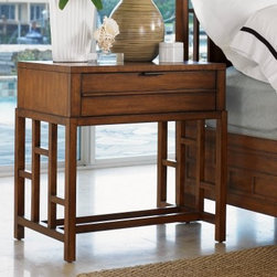 Tommy Bahama by Lexington Home Brands Ocean Club Kaloa 1 Drawer Nightstand - The Tommy Bahama Ocean Club Kaloa 1 Drawer Nightstand has an open, energetic design with a touch of Asian influence. Its sturdy frame is constructed from select hardwood solids and is protected with a beautiful Sienna Bali finish that helps emphasize the design. A single storage drawer is incorporated seamlessly into the design, perfect for storing reading glasses, cellphones, tablets, and e-readers. The legs of the piece are joined by an open fretwork design that adds a playful touch to the overall design.About Lexington Home BrandsFounded in 1903 in High Point, NC, Lexington Home Brands has become a globally known manufacturer and marketer of unique home furnishings. They are an industry leader in design, style, and quality products. Their product line consists of upholstered and hardwood furniture under recognized brands such as Lexington, Tommy Bahama, Sligh, and Henry Link Trading Co.. Lexington Home Brand's intentions and aspirations are to create exclusive designs and styles that accommodate the traditional, contemporary, casual, and formal decors of their customers' homes.