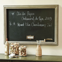 "Ballard Designs - Rectangular Magnetic Chalkboard - Chalk is not included. Do not use with liquid chalk. With its great style and versatility, this magnetized Chalkboard deserves to hang front and center. Chalkboard includes a magnetized brass ""Paris"" crest and a chalk ledge that can be moved, so you can hang it either way. Molded frame is crafted of metal in painted zinc finish with an aged and imperfect industrial appeal.Rectangular Magnetic Chalkboard features: . ."
