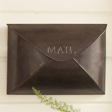 "Antique Envelope Mailbox - This traditional mailbox is fun and has a sleek profile.  The form is simple but smart, not intrusive but allowing plenty of space for mail.Made of iron with a bronze or antique nickel finish.16"" wide by 5"" deep by 11"" high"