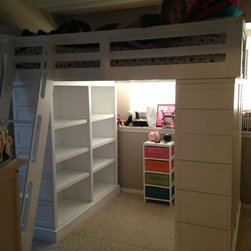 Loft Beds - This is a loft bed.  The left base has two side by side bookcases.  The right base has a single bookcase to the rear of the base.  The front of the right base is a six drawer dresser. photo by j clark