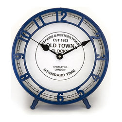 Old Town Modern Time Clock in Blue - Perch the Old Town Modern Time Metal Clock on your bedside table or shelves for a classic look. Clear numbers are pointed out by quartz-powered elegant black hands.