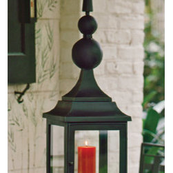 Iron Maison Lantern - This iron lantern has a very serious, stately look about it. While it won't be good out in the direct weather, it would look terrific on a side table on a porch or covered patio. The sheer size if it will make sure it does its job contributing beautiful candlelight to help set the scene for summer dinner parties.