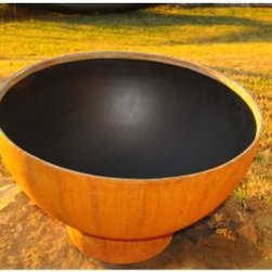Fire Pit Art Crater Fire Pit - The Fire Pit Art Crater Fire Pit isn't just an outdoor pit, it's a work of art. The pure, classic minimalist design of this piece is a one of a kind, signed and individually numbered by its designer, Rick Wittrig. Constructed of heavy-gauge, quarter-inch-thick carbon steel, the Fire Pit Art Crater Fire Pit has been forged to bring you years of heavy use. The exterior is coated in a protective iron oxide finish that comes in a vibrant patina color. The interior is lined in high-temperature paint and has a 1.5-inch rain drain in the bottom so you won't ever have stagnant water after a rainstorm. No maintenance is required. No maintenance is required. Spark guard, stone ground base, and log rack sold separately. Measures 36 diam. x 24H inches.