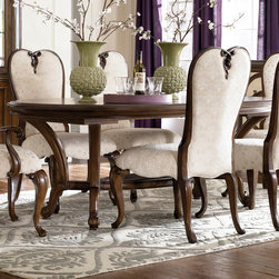 """American Drew - American Drew Jessica McClintock Renaissance Dining Table in Mink - Welcome to the Jessica McClintock Home, by American Drew. This Collection combines the romantic elements of Jessica into a """"New Traditional"""" styling. This collection truly captures the past, present and future together. The combination of materials such as fine veneers, marble, leather and mirror, the dramatic serpentine and bowed shapes, he use of elements from fashion and nature, and the custom, jewelry-like hardware all add a unique flare to this collection that is like nothing before. This Collection is crafted from highly figured Walnut Veneers, Prima Vera and Maple Marquetry in a Mink finish. A Silver Leaf finish is offered on select pieces, giving them a soft, veiled-platinum appearance. Unique pieces abound in Jessica McClintock Home. The Antiqued Mirror Leg Dining Table, the Silver Leafed Leather Bed with Crystal-like buttons, the Dressing Armoire and Silver Leaf Serpentine Chest all create beautiful focal points in every room of your home. Gracious scaled items, eclectic mixture of materials and designs and the romantic touch of Jessica come together to create a collection of furniture that will add a high end style to any home. - 908-744R.  Product features: Belongs to Jessica McClintock Collection by American Drew; Dining Table; Oval Table Top Shape; Double Pedestal Table Type; Walnut veneers and maple; Old World charm and romantic Victorian design aesthetics; Traditional Style; Mink Finish. Product includes: Table Top (1); Table Base (1). Renaissance Dining Table in Mink belongs to Jessica McClintock Couture Collection by American Drew."""