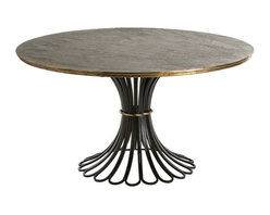 Draco Dining Table - Seat guests at a sumptuous surface with the Draco Dining Table, a radiantly-composed furniture icon given dark, dramatic significance by the finishes of its metal structures. The wide top of this round dining-room table rests on an inverted flower of black iron loops, while a crosshatched texture on the surface ensures that with or without a table cloth, the look is deeply personal.