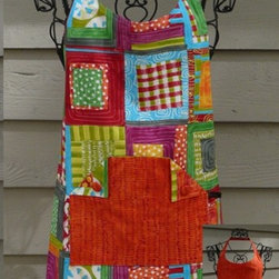 Stitch in Color - Designer Apron by PaisleyLady. Two large pockets with fabric covered buttons on front of apron, with reversible colors used in pockets.