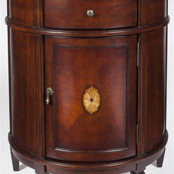 Butler - Demilune Chest in Light Cherry - linen-fold inlay on the door front. Antique brass-finished hardware. Made from poplar solid wood and MDF. 28 in. W x 14 in. D x 32 in. H (44 lbs.)