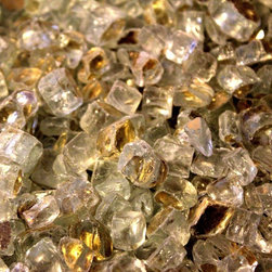 "American Fireglass Gold Reflective | 1/2-in Fire Glass | 1 lb - AFF-GDRF12 American Fireglass Gold Reflective 1/2"" Crystal Brilliance Fireplace Gems 1 lb Sold in 1 lb Bags Gold Reflective Fire Glass is available in our 1/2"" Premium Collection. Gold Reflective is the ultimate choice from our Premium Collection. It is a clear glass with a gold tint on one side and mirror like reflective on the other. The rich look of Gold Reflective Fireglass will define your classy taste in decor and represent exactly who you are. The reflective properties offer a brilliant sparkle under the mid day sun or a reflection of fire while the flame is burning after dark. An Average 36"" Fireplace Takes Approximately 60 lbs. of gems An Average 42"" Fireplace Takes Approximately 80 lbs. of gems Lava granules can be used initially on the burner then covered with Fireglass Gems to reduce the amount needed Combine multiple gem colors for spectacular fire!"