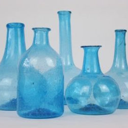 Vintage Decorative Blue Bottle - These vintage blue bottles look fabulous grouped together in the corner of a counter or on open shelving in a kitchen. The translucency and vibrant hue are beautiful, making a dramatic presentation for a few wisps of beach grass or a solitary bloom. Conversely, serve drinking water in them, spread out along your dining table.