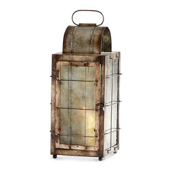 Old Timer Candle Lantern #1 - Glass spotted with age and metal discolored with time give an enchanting sense of the fragile yet grounded to an article of home d�cor, and the Old Timer Candleholder adds the flicker of candlelight to this evocative appearance.  With a delicate grid of metal bars protecting each pane and ball feet to stand on, this traditional candle lantern feels alluringly practical.