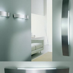 "Oty Light - Oty Light Fila wall sconce 39/57/78/200 - The Fila wall sconce by Oty light has been designed by S.T.O. in 2001. This perfect contemporary light is elegantly curved and can be used above mirrors in the bathroom or any other modern interior setting. It is available in different finishes such as: aluminum painted metal, brushed steel or white metal. You can choose from halogen or fluorescent version.  The Fila wall sconce by Oty light has been designed by S.T.O. in 2001. This superior quality contemporary light is elegantly curved and can be used above mirrors in the bathroom or any other modern interior setting. It is available in different finishes such as: aluminum painted metal, brushed aluminum or white metal. You can choose from halogen or fluorescent version.                         Manufacturer:             Oty light                             Designer:                         S.T.O                                         Made in:            Italy                            Dimensions:                         small: length: 15"" 1/4"" (39cm) proj: 3 1/2"" (9cm)             medium length 22 3/8"" (57cm) proj: 3 1/2"" (9cm)             large: length 30"" (78cm) proj: 3"" 3/4 (11cm)             extra large: length: 39 1/3"" (100cm) 3 3/4"" (11cm)                                         Light bulb:                         small: 1 x max 100W double ended Halogen or G24d2 1 x 18W fluorescent             medium: 1 x max 150W double ended Halogen or G24d3 1 x 26W fluorescent             large: 2 x max 100W double ended Halogen or G24d3 2 x 26W fluorescent             extra large: 3 x max 100W double ended Halogen or 2G11 1 x 55W fluorescent                                         Material:             metal"