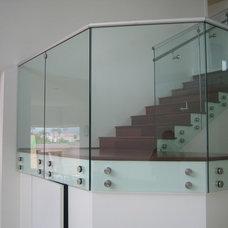 Modern Staircase by Jim Lowe Glass, LLC