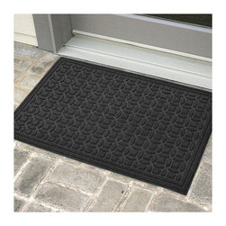 Frontgate - WATER & DIRT SHIELD ™ Green Piece Entry Mat - Made of recycled PolyEthylene Terephtalate (PET), the main ingredient in plastic drinking bottles. Unique design traps dirt and moisture beneath shoe level. Dries quickly. Won't fade or rot. Slip-resistant rubber backing is made of recycled rubber car tires. The all new WATER & DIRT SHIELD ™ Green Piece Entry Mat is possibly the most environmentally friendly mat available today. It is constructed of 100% recycled PET face fiber and a 100% recycled rubber backing. This mat is exceptional for high-traffic areas, and its pile won't crush, providing high performance and extended product life.  .  .  .  .  . Suitable for all floor types. Use indoors or outdoors . Easy care – just hose off and air dry . Note: Do not place on wet floors.