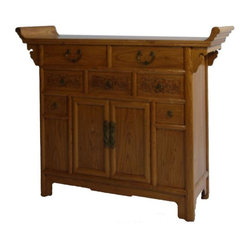 Chinese Elm Dresser - This Asian antique dresser features detailed molding for truly unique appeal. Dark brass hardware provide cool Asian accents that complement the light wood finish. Seven drawers of varying sizes sit above cabinet doors for lots of sleek hidden storage.