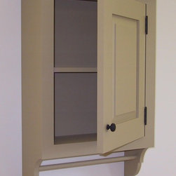 Hanging Cabinet - This is a traditional hanging cabinet with decorative scroll work and towel bar.  Raised pael door, adjustable shelves.