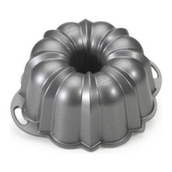 Nordic Ware Platinum Collection Nonstick Cast Aluminum Anniversary 12 Cup Bundt - Nordic Ware the designer of the original bundt pan created this Nordic Ware 50037 Platinum Collection Nonstick Cast Aluminum Anniversary 12 Cup Bundt Pan as its tribute to 60 years of delicious Bundt cakes. This amazing pan is constructed of commercial-quality durable heavy-duty cast aluminum that ensures sharp detail and uniform baking. The pan is from Nordic Ware's Platinum Bakeware collection and features handles that allow you to easily lift the pan leaving a beautifully formed bundt cake. The heat-reflective exterior ensures even baking and the nonstick interior assures quick release and cleanup. It's dishwasher-safe and will not rust or warp. 15-cup capacity. Dimensions: 10.25 diam. x 3.625H inches. Complete with lifetime manufacturer's warranty.About Nordic Ware.Founded in 1946 Nordic Ware is a family-owned American manufacturer of kitchenware products. From its home office in Minneapolis Minn. Nordic Ware markets an extensive line of quality cookware bakeware microwave and barbecue products. An innovative manufacturer and marketer Nordic Ware is best known for its Bundt Pan. Today there are nearly 60 million Bundt pans in kitchens across America.The Nordic Ware name is associated with the quality dependability and value recognized by millions of homemakers. The company's extensive finishing technology and history of quality innovation and consistency in this highly technical and specialized area makes it a true leader in the industrial coatings industry.Since founding Nordic Ware in 1946 the company has prided itself on providing long-lasting quality products that will be handed down through generations. Its business is firmly rooted in the trust dedication and talent of its employees a commitment to using quality materials and construction a desire to provide excellence in service to customers and never-ending research of consumer needs.