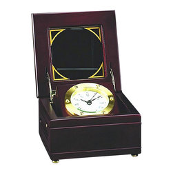 """Solid Brass Gimbal Quartz Clock in Mahogany Wood Box - The solid brass gimbal clock in mahogany wood box measures 3.5""""H x 5.75""""W x 5.75""""D. The clock is quartz and it comes in a solid brass tarnish proof case with a mahogany wood box. It will add a definite nautical touch to whatever room it is placed in and is a must have for those who appreciate high quality nautical decor. It makes a great gift, impressive decoration  will be admired by all those who love the sea."""
