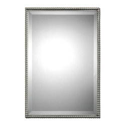 Sherise Rectangle Mirror - In the Sherise Rectangle Mirror, one may catch the reflection of a shimmering midday sun, a sliver of silver moon, a posy of blooms peeking out from a vase, or the winsome smile of someone dear. The mirror boasts a glimmering metal frame of brushed nickel with a decorative beading design; a generous bevel suggests old-world glamour. The piece may be hung horizontally or vertically, allowing for ease in placement.