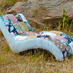 Vintage Furniture Redesigned - This retro shaped vintage chaise lounge has been covered in a unique rectangular shaped patchworking.  It has been tufted with floral vintage buttons and using an assortment of visually pleasing boho vintage floral patterns.  These beautiful patterns remind me of the finest vintage wallpaper and draperies of the 70's!  It's taking the creme de la creme of our past and modifying it for today's design enthusiast!