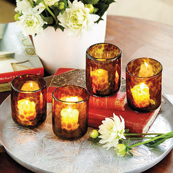 Ballard Designs - Tortoise Votive Holders - Set of 4 - Works with any table setting. Use with real or flameless votive. Candles not included. Tortoise Glass is one of our favorite accents. These Tortoise Votives are handmade of mouth-blown recycled glass, giving them an artisanal look and feel. When lit, they cast a warm golden glow over your table or mantel. Tortoise Votive features:.  . .