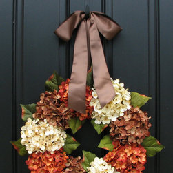 Fall Wreath by Two Inspire You - The hydrangea in my yard have been trimmed back for the cold season, but it doesn't mean that I have to go without them this Thanksgiving. I love the trifecta of color in this pretty hydrangea wreath.