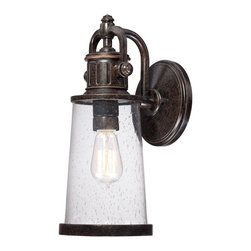 Quoizel - Quoizel Imperial Bronze Exterior - SKU: SDN8407IBFL - This fixture gives the exterior of your home both beauty and an industrial sense of design. It features a vintage bulb for a historic look and is enhanced by the clear seedy glass. The Imperial Bronze finish completes the look.
