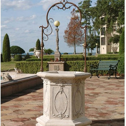 Design Toscano - Village Square Architectural Garden Well - NE140603 - Shop for Sculptures Statues and Figurines from Hayneedle.com! Inspired from the majestic garden wells of Europe the Village Square Architectural Garden Well makes a striking statement in any setting. This beautiful piece features a base cast in designer resin and an arch in intricate wrought iron. A realistic stone finish complements the patina of the arch perfectly offering a vintage look that will enhance any garden or courtyard setting.About Design Toscano: Design Toscano is the country's premier source for statues and other historical and antique replicas which are available through our catalog and website. We were named in Inc. magazine's list of the 500 fastest growing privately-held companies for three consecutive years - an honor unprecedented among catalogers. Our founders Michael and Marilyn Stupak created Design Toscano in 1990. While on a trip to Paris the Stopkas first saw the marvelous carvings of gargoyles and water spouts at the Notre Dame Cathedral. Inspired by the beauty and mystery of these pieces they decided to introduce the world of medieval gargoyles to America in 1993. On a later trip to Albi France the Stopkas had the pleasure of being exposed to the world of Jacquard tapestries that they added quickly to the growing catalog. Since then our product line has grown to include Egyptian Medieval and other period pieces that are now among the current favorites of Design Toscano customers along with an extensive collection of garden fountains statuary authentic canvas replicas of oil painting masterpieces and other antique art reproductions. At Design Toscano we pride ourselves on attention to detail by traveling directly to the source for all historical replicas. Over 90% of our catalog offerings are exclusive to the Design Toscano brand allowing us to present unusual decorative items unavailable elsewhere. Our attention to detail extends throughout the company especially in t