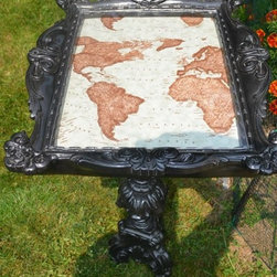 Black Victorian style side table - Upcycled ceramic base and picture frame have been uniquely assembled together, painted with several layers of black gloss, to create a distinctive piece of furniture for those who want to add a bit of a bold, classy Victorian look to their furnishings. Inside the frame features a fabric print of an old world map covered with a Plexiglas overlay. This unique accent table will prove to be a conversation starter wherever it is placed in your home.