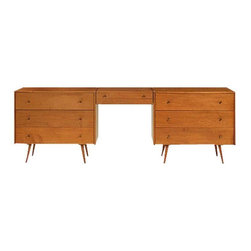 Paul McCobb Dressers & Removable Cantilever - This rare set was designed by Paul McCobb (1917-1969) as part of the Planner Group for Winchendon. Circa 1955, it features a removable cantilevered vanity which rests between matching three drawer dressers. The vanity, which attaches to either side of the dressers, has a flip top with an interior mirror and inset storage compartments. The set retains all original hardware including McCobb's signature brass pulls. The dressers rest on splayed legs typical of the designer and the period. Designer and manufacturer are identified inside a drawer. Circa 1950s USA. Made of Blond Maple, brass, and mirrored glass.