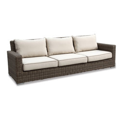 Thos. Baker - Wicker Outdoor Large Sofa w/Cushions | Hampton Collection - Oversized seating in all-weather wicker with a slightly weathered look inspired by classic whitewashed country home styles. Premium, dyed-through resin wicker with an extra large diameter profile and elegant ocean gray finish. Powder-coated aluminum subframe and brushed aluminum feet.Plush Sunbrella cushion sets included where applicable. Choose quick ship in khaki with cocoa piping, stone green or choose from our made-to-order fabric options.Made-to-order cushion sales are final and ship in 2-3 weeks.