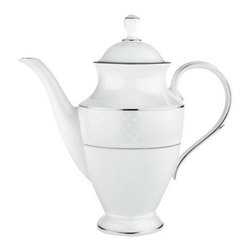 Lenox - Lenox Venetian Lace Coffeepot with Lid - 762026 - Shop for Sets from Hayneedle.com! The Lenox Venetian Lace Coffeepot with Lid may inspire you to enjoy a cup of authentic Italian coffee with its traditional style. Crafted from bone china the white-bodied 48-ounce coffeepot is accented with precious platinum to create a beautiful presence on your table. The coffeepot features a gracefully curved handle and spout. The coffeepot stands 10.5 inches tall and is dishwasher-safe for easy cleaning.About LenoxThe Lenox Corporation is an industry leader in premium tabletops giftware and collectibles. The company markets its products under the Lenox Dansk and Gorham brands propelled by a shared commitment to quality and design that makes the brands among the best known and respected in the industry. Collectively the three brands share 340 years of tabletop and giftware expertise.