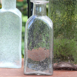 Vintage Glass Bottle Rect - Sm - Antique Lilac - Aged glass fills your home with subtle color, classic shape, and the indefinable pleasure of collected d�cor based on precious, humble treasures.  The Vintage Glass Bottle in Antique Lilac is small but sturdy in its timeless apothecary profile; a delicate, barely-there tint of soft purple-grey hue is evoked from the glass by interior lights or by the glow of filtered sunlight.