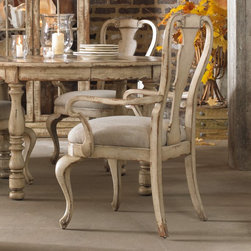 Hooker Furniture - Wakefield Splat Back Dining Arm Chairs - Set of 2 Multicolor - HOOK1734 - Shop for Dining Chairs from Hayneedle.com! The Wakefield Splat Back Dining Arm Chairs - Set of 2 will make you feel like you're dining in a cottage in the French countryside. These quaint chairs feature a marriage of traditional design and country charm to brighten up your dining space. The design has graceful legs an urn-shaped back and scrolled detail carving all finished in a distressed off-white for a look that's elegant shabby-chic.The chairs have sturdy frames constructed from hardwood solids with cherry and pine veneers meaning they can withstand many family meals and gatherings of loved ones. And these chairs are sure to set an easy comfortable setting with our without a mason jar of wildflowers on the table.Not available for sale in or delivery to the state of California.About Hooker Furniture CorporatqionFor 83 years Hooker Furniture Corporation has produced high-quality innovative home furnishings that seamlessly combine function and elegance. Today Hooker is one of the nation's premier manufacturers and importers of furniture and seeks to enrich the lives of customers with beautiful trouble-free home furnishings. The Martinsville Virginia based company specializes in lifestyle driven furnishings like entertainment centers home office furniture accent tables and chairs.Construction of Hooker FurnitureHooker Furniture chooses solid woods and select wood veneers over wood frames to construct their high-quality pieces. By using wood veneer pieces can be given a decorative look that can't be achieved with the use of solid wood alone. The veneers add beautiful accents of color and design to the pieces and are placed over engineered wood product for strength. All Hooker wood veneers are made from renewable resources and are located primarily on the flat surfaces of the furniture such as the case tops and sides.Each Hooker furniture piece is finished using up to 30 different steps including 13 steps of hand-sanding and accenting. Physical distressing is done by hand. Pieces receive two to three coats of solid lacquer to create extra depth and add durability to the finish. Each case frame is assembled using strong mortise-and-tenon joints which are then reinforced by mechanical fasteners and glue. On most designs end panels extend to the floor to add strength and stability. Panel-style furniture features strong panel and frame construction to help avoid warping.Your Hooker furniture features finished case interiors to eliminate unsightly raw wood and to help protect items you may store inside drawers or cabinets. Drawer parts are given a urethane or lacquer finish to create smooth action and durability. All drawers use dovetails either English or French for years of problem-free use. Drawer bottoms are constructed from plywood and attached to the plywood drawer sides via the use of hot glue and/or wood glue blocks. Most drawers are full width depth and height to provide the maximum amount of storage space.