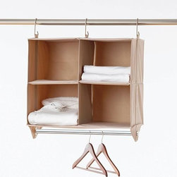 Home Decorators Collection - ClosetMAX 4-Cubby Organizer - Our ClosetMAX 4-Cubby Organizer helps you creates cubby storage in your closet without sacrificing vital hanging space. Four reinforced shelves offer storage for folded clothing, shoes or other accessories. Meanwhile, the lower bar provides hanging space for shirts, skirts and folded pants. Four reinforced canvas shelves. Lower bar for hanging clothes. Polyester fabric easily wipes clean. Thick metal hanging hooks and strong nylon straps work with any closet bar. Durable grommets allow for combination with other ClosetMAX items. No tools required for installation.