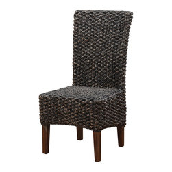 Modus Furniture International - Meadow Wicker Dining Chair in Brick Brown (set of 2) - Inspired by the bold, industrial character of an early 20th century work table, the Meadow dining collection brings warmth, individuality and character to your space.  Constructed entirely from solid Acacia, a hardwood known for stunning grain patterns and rich contrasting colors, each piece is wire brushed, hand-glazed and hand-finished, creating wood surfaces that radiate texture and depth of color.  Matching chairs are finely hand woven from Water Hyacinth, a sustainable and renewable fiber. The table expands from 63 to 95 inches, comfortably seating up to 8 guests for intimate or larger gatherings.