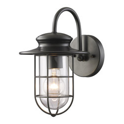 Elk Lighting - EL-42284/1 Portside 1-Light Outdoor Sconce in Matte Black - Years ago, nautical lighting was purpose built to withstand heavy storms and battering winds. Inspired by those nostalgic lighting fixtures, this series has a simple and charming design finished in matte black with clear blown glass.