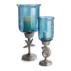 Starfish Hurricane - These hurricane lamps have a fun beach motif with shells and starfish featured on the base with blue glass the color of the Gulf of Mexico.