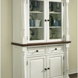 Home Styles Monarch China Cabinet - White & Oak - You can safely store and proudly display your fine dinnerware and other treasures inside the Home Styles Monarch China Cabinet - White & Oak. A useful addition to a dining room this spacious cabinet consists of a top hutch and bottom buffet for generous storage. The buffet features two felt-lined drawers with dividers to organize silverware and utensils and there's a cabinet with two adjustable shelves for cups saucers place mats tablecloths and other items. You can display your favorite dishes behind the glass door cabinets on the hutch which has shelving to accommodate a variety of dining essentials. Constructed of hardwood solids engineered woods and veneers this china cabinet features a rubbed white finish and multi-step distressed oak finish. Crown moldings solid wood pilasters with intricate carved detail picture frame moldings and round metal hardware bring out the warm elegant style of this versatile piece. About Home StylesHome Styles is a manufacturer and distributor of RTA (ready to assemble) furniture perfectly suited to today's lifestyles. Blending attractive design with modern functionality their furniture collections span many styles from timeless traditional to cutting-edge contemporary. The great difference between Home Styles and many other RTA furniture manufacturers is that Home Styles pieces feature hardwood construction and quality hardware that stand up to years of use. When shopping for convenient durable items for the home look to Home Styles. You'll appreciate the value.