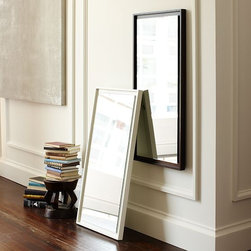 Floating Wood Wall Mirror - This expansive mirror appears to float within its solid wood frame. A versatile piece, it can be hung vertically or horizontally to add a bright, light-reflecting spot to any space.