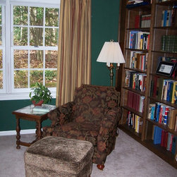 Traditional Window Treatments, Updated for Today. - A classic stripe gets an update in this Library drapery.  Top tacked Euro pleats are mounted on a wrought iron pole.  The gold draperies lighten the classic hunter green walls, and warm the space.
