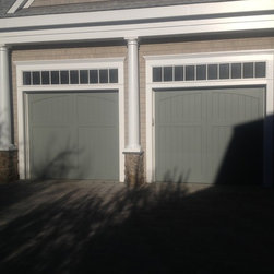 Carriage House Doors - Two custom Extira composite doors with 5' V-groove and arched top