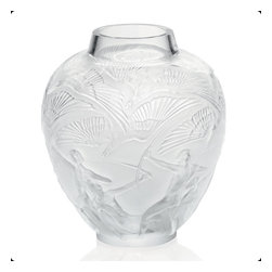 Lalique - Lalique Archers Vase Clear - Lalique Archers Vase Clear 10206700  -  Size: 8.46 Inches Long x  12.2 Inches Tall  -  Genuine Lalique Crystal  -  Fully Authorized U.S. Lalique Crystal Dealer  -  Created by the Lost Wax Technique  -  No Two Lalique Pieces Are Exactly the Same  -  Brand New in the Original Lalique Box  -  Every Lalique Piece is Signed by Hand, a Sign of its Authenticity and Quality  -  Created in Wingen on Moder-France  -  Lalique Crystal UPC Number: 090592944714