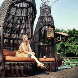 Award Winning Garden Furniture - The eye catching tower-shape Wicker Garden Seating is one of the most innovative designs at Cologne International Furniture Expo. The garden set is highly versatile, assembled by 3 standalone pieces - 2 comfortable chairs and 1 stylish table.