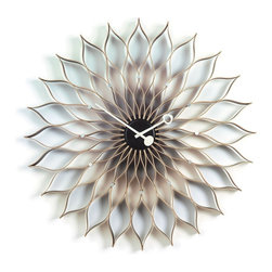Vitra - Vitra Nelson Sunflower Clock - Breathtaking sculptural beauty defines this midcentury modern clock, which will bring elegance and vintage glamour to your home. Designed by George Nelson, this beechwood clock has metal accents and hands, and will simply blossom on your wall.