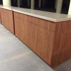 office, file cabinets. - no- drip solid surface countertop, cherry laminated.