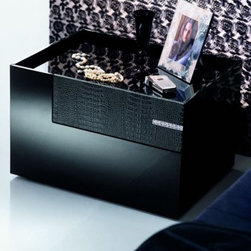 Diamond Black Croc Leather Nightstand - Diamond Black Croc Leather NightstandThis nightstand showcases a modern sensibility with stylish flair. You can choose the option of Left or Right side or if you like order both for a coordinating look. A single spacious drawers with black croc leather drawer front opens with a smooth glide and provide ample room for bedside items. Genuine Strass Swarovski crystals form a slender inlay on the top drawer front adds to the excentric look to this piece. This piece is designed with 2 drawers that seem hidden the croc leather front opens the smaller drawer on top the 2nd drawer below it in a unique L-shape design appears with the full front face great functionality along with fabulous looks. The sunken top is a pleasant feature to keep all items handy and in place. Made in Italy this stunning accent piece delivers all the quality and superior design you'd expect from contemporary Italian-made furniture. About Rossetto USARossetto USA is the U.S. division of the Arros Group a leading manufacturer that exports Italian furniture style and design all over the world. Operating out of its warehouse in High Point N.C. since 1999 Rossetto provides complete contemporary and modern dining bedroom and occasional furniture programs that combine affordable price with innovative Italian design to satisfy the demands of their distinguished customers.