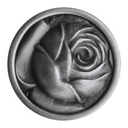 """Inviting Home - McKenna's Rose Knob (antique pewter) - Hand-cast McKenna's Rose Knob in antique pewter finish; 1-1/4"""" diameter Product Specification: Made in the USA. Fine-art foundry hand-pours and hand finished hardware knobs and pulls using Old World methods. Lifetime guaranteed against flaws in craftsmanship. Exceptional clarity of details and depth of relief. All knobs and pulls are hand cast from solid fine pewter or solid bronze. The term antique refers to special methods of treating metal so there is contrast between relief and recessed areas. Knobs and Pulls are lacquered to protect the finish. Alternate finishes are available. Detailed Description: The McKenna Rose knobs are pleasantly delicate. With the large rose designs the McKenna Rose differs from a lot of the other pulls in our collections due to the design making a lot less severe impact with the softer lines of the overall design. It would of course look great with the matching McKenna Rose knobs - any other knobs that you would like to use along side of the McKenna Rose pulls have to be equally as delicate."""