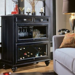 "American Drew 919-589 Bookcase/Bar- RTA Feet Camden - Black - Bookcase/Bar- RTA Feet - American Drew Camden - Black Collection 919-589The compact sized Bookcase by American Drew is a smart choice for your smart home. Having 2 drawers and 2 open compartments this is going to meet your needs. Suavely sculpted it grabs the eyeballs spontaneously. The excellent wooden material does not perish with moisture or dust attack. The surface is made slippery smooth with glossy coat that prevents the stains from sticking to the surface. Regular care would keep its shine intact. Stout and robust American Drew 919-589 is a bold and contemporary purchase.Features:2 DrawersGlass Fold-Up Door w/ Wine Glass Storage on LeftOpen Compartment on RightGlass Fold-up Door w/ Removable Wine Rack on BottomThis Price Includes:Bookcase/Bar- RTA FeetItem:Weight:Dimensions:Bookcase/Bar- RTA Feet188 lbs38"" W X 18"" D X 42"" HManufacturer's Materials:Hardwood SolidsMaple Ash Veneers & Select Hardwoods"