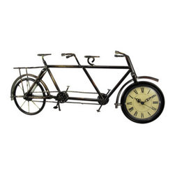 Metal Bicycle Built For Two Table/Desk Clock - This beautiful metal vintage bicycle built for two desk or table clock has an antiqued bronze finish to give it an aged look. Measuring 8 1/8 inches tall, 19 1/2 inches wide, and 3 1/2 inches deep, it shows excellent detailing, and adds class and style to any room. The clock is 3 1/2 inches in diameter, with black hands and markers. It runs on a single AA battery. This also makes a great present for the holidays or for housewarming gifts.